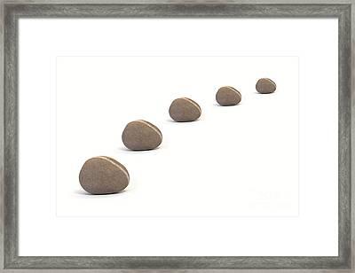 Five Calm Pebbles Against White Background Framed Print by Natalie Kinnear
