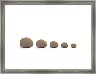 Five Pebbles Against White Background Framed Print by Natalie Kinnear