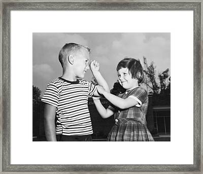 Five Year Olds Check Muscles Framed Print by Underwood Archives