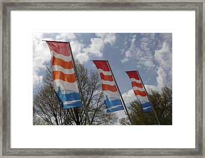 Flags Fluttering In The John Frost Bridge Framed Print by Ronald Jansen