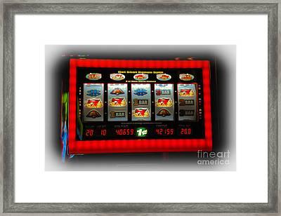 Flaming Sevens Slots Framed Print by Gary Keesler