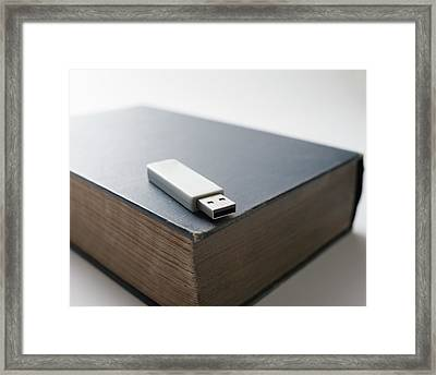 Flash Drive And Old Book Framed Print by Robert Brook