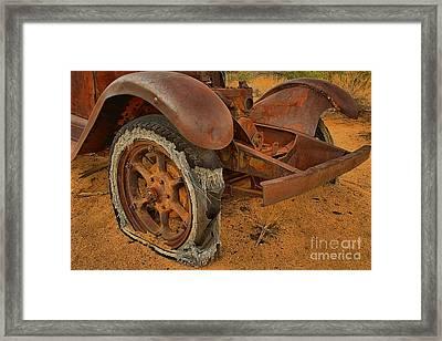 Flat Tire Framed Print by Adam Jewell