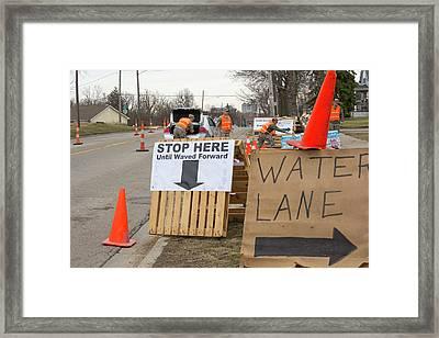 Flint Bottled Drinking Water Distribution Framed Print by Jim West