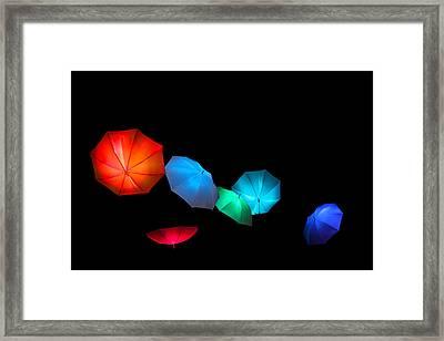 Floating Umbrellas  Framed Print by James Hammen