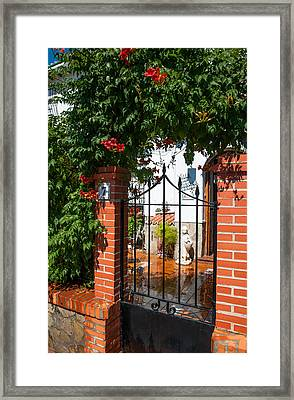 Flowered Entrance. Ronda. Andalusia Framed Print by Jenny Rainbow