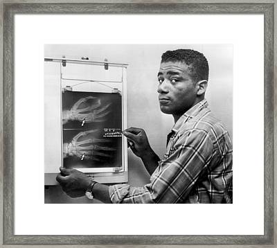 Floyd Patterson Looking At X Ray Framed Print by Retro Images Archive