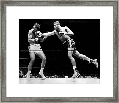 Floyd Patterson Throwing Hard Punch Framed Print by Retro Images Archive