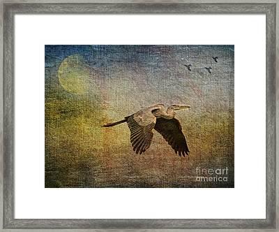 Flying Near The Moon Framed Print by Deborah Benoit