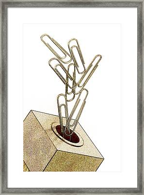 Flying Paperclips Framed Print by Carol Leigh