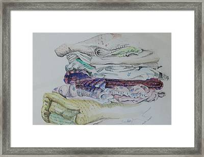 Folded Clothes Framed Print by Gloria Jones