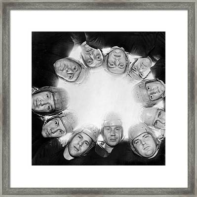 Football Team Huddle Framed Print by Underwood Archives
