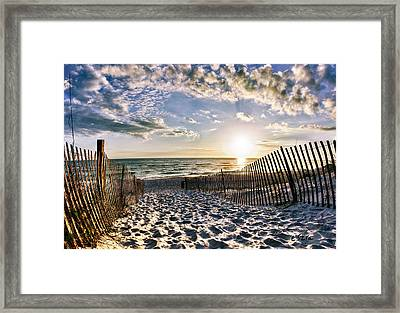 Footprints In Sand Beach Sunset Framed Print by Eszra Tanner