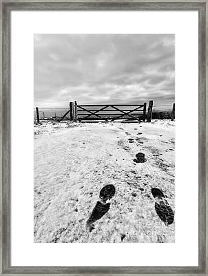 Footprints In The Snow Framed Print by John Farnan