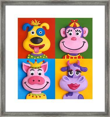 Four Animal Faces Framed Print by Amy Vangsgard