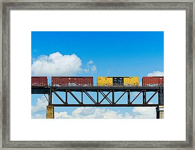 Freight Train Passing Over A Bridge Framed Print by Panoramic Images