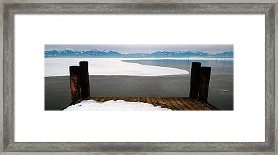 Frozen Lake In Front Of Snowcapped Framed Print by Panoramic Images