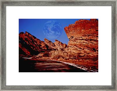 Full Earth Over Red Rocks Framed Print by Kellice Swaggerty