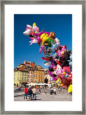 Balloons Tied Together And Tourist Walking  Framed Print by Arletta Cwalina