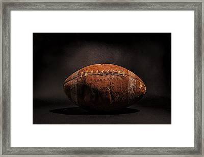 Game Ball Framed Print by Peter Tellone