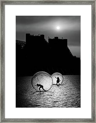 Games In A Bubble Framed Print by Juan Luis Duran