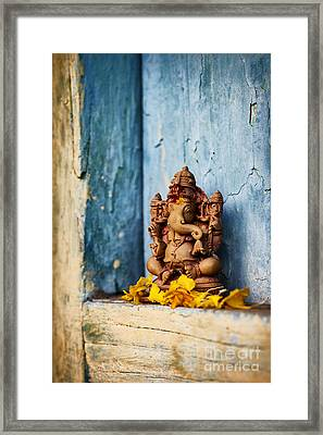 Ganesha Statue And Flower Petals Framed Print by Tim Gainey