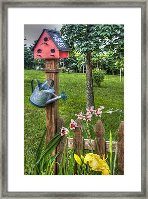 Garden By The Fence Framed Print by Jim Plogger