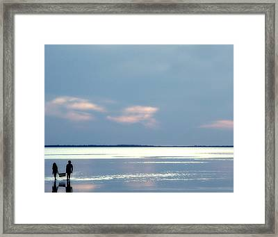 Gathering Clams Framed Print by David and Carol Kelly