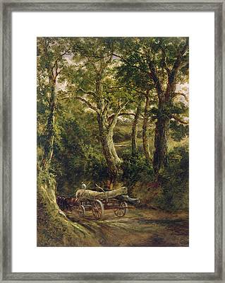 Gathering Timber Oil On Canvas Framed Print by Henry Earp