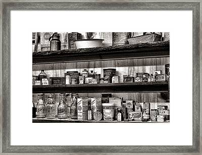 General Store Shelves Framed Print by Olivier Le Queinec