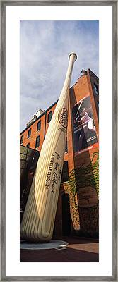 Giant Baseball Bat Adorns Framed Print by Panoramic Images