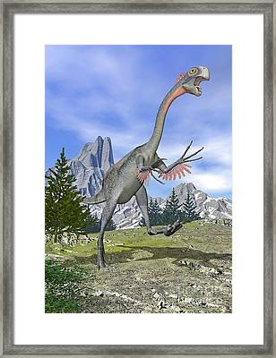 Gigantoraptor Dinosaur Running Framed Print by Elena Duvernay