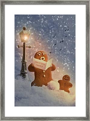 Gingerbread Carol Singers Framed Print by Amanda Elwell