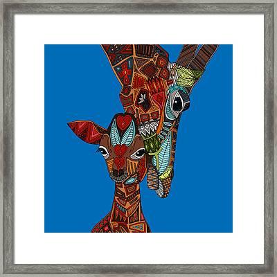 Giraffe Love Blue Framed Print by Sharon Turner