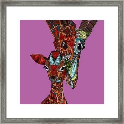 Giraffe Love Orchid Framed Print by Sharon Turner