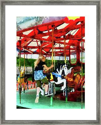 Girl Getting On Merry-go-round Framed Print by Susan Savad