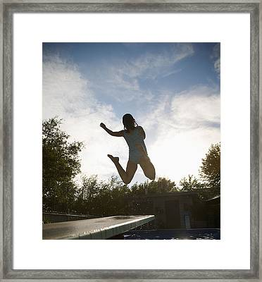 Girl Jumping Into Pool Framed Print by Kelly Redinger