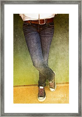 Girl Leaning Against Wall Framed Print by Birgit Tyrrell