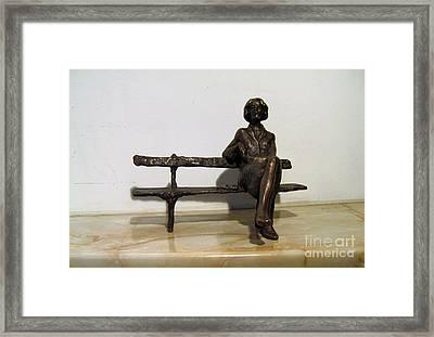 Girl On Bench Framed Print by Nikola Litchkov