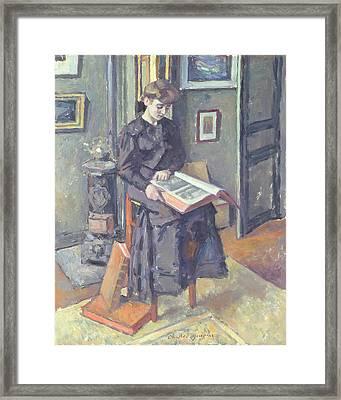 Girl Reading A Book Framed Print by Charles Francois Prosper Guerin