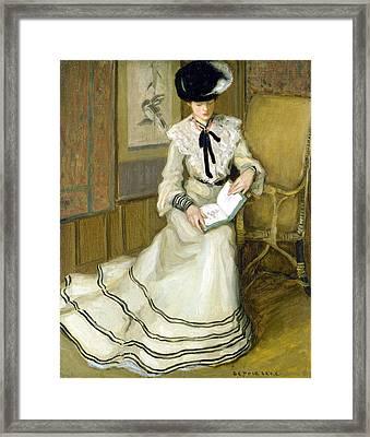 Girl Reading Framed Print by Carl Frieseke