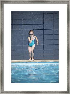 Girl Runs Into Swimming Pool Framed Print by Kelly Redinger