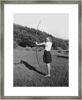 Girl Scout With Bow And Arrow Framed Print by Underwood Archives