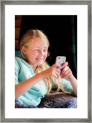 Girl Using A Smartphone Framed Print by Samuel Ashfield