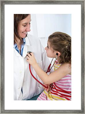 Girl Using A Stethoscope On Doctor Framed Print by Lea Paterson