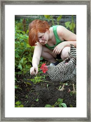 Girl With Free Range Chicken Framed Print by Jim West
