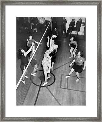 Girls Playing Volleyball Framed Print by Underwood Archives