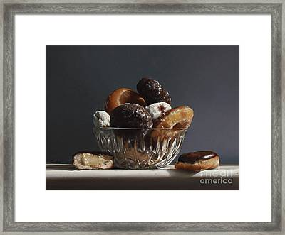 Glass Bowl Of Donuts Framed Print by Larry Preston