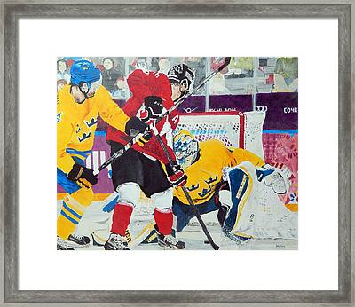 Golden Goal In Sochi Framed Print by Betty-Anne McDonald
