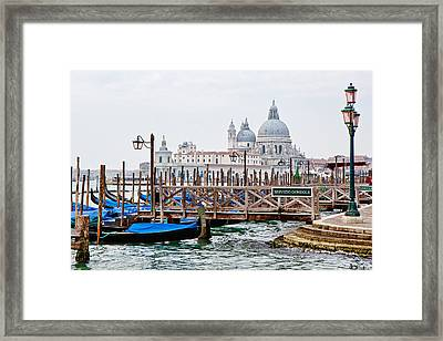 Gondola Station In Venice Framed Print by Susan Schmitz